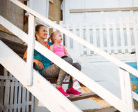 Healthy mother and baby girl sitting on stairs Royalty Free Stock Images