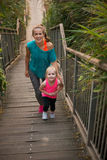 Healthy mother and baby girl walking on stairs Royalty Free Stock Image
