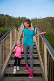 Healthy mother and baby girl walking on stairs Stock Photography