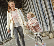 Healthy mother and child on Pont de Bir-Hakeim bridge walking Royalty Free Stock Images