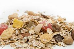Healthy muesli. A close up macro of delicious healthy muesli with dry bits of pawpaw, pineapple, prunes and raisins Royalty Free Stock Image