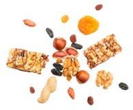 Healthy muesli bar burst. Muesli bar bursting with ingredients: nuts, raisins, apricot. Healthy eating concept Stock Photography