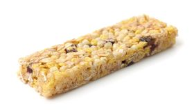 Healthy muesli bar made of cereals, honey and dried berries Royalty Free Stock Photos