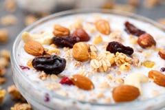 Healthy muesli breakfast with nuts and raisin Stock Photos