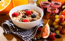 Healthy muesli with fresh berries and fruit Royalty Free Stock Images