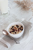 Healthy muesli and raisins. Healthy breakfast with muesli and raisins. Glass of milk on the background royalty free stock photo