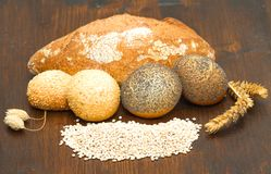 Healthy multi grain bread on wood. Some healthy multi grain bread on wood Royalty Free Stock Photo
