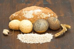 Healthy multi grain bread on wood. Some healthy multi grain bread on wood Stock Photography