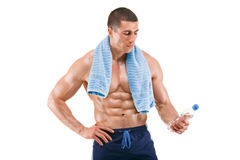 Healthy muscular man holding bottle of water. Naked torso. Isolated Stock Photography