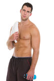 Healthy muscular man with towel after workout Stock Photography