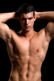 Healthy muscular young man. Isolated on black background Stock Images