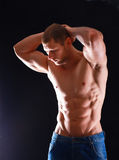 Healthy muscular young man.  on black background Royalty Free Stock Image