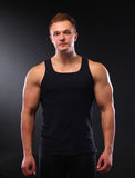 Healthy muscular young man. Isolated on black Stock Image