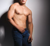 Healthy muscular young man. Isolated on black background Stock Photos