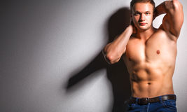 Healthy muscular young man. Isolated on black background Stock Photography
