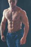 Healthy muscular young man. Isolated on black background Stock Image