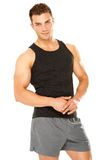 Healthy muscular young man isolated on white Stock Images
