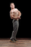 Healthy muscular young man in studio royalty free stock photography