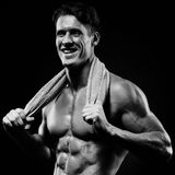 Healthy muscular young man after a workout on dark background.Fi Royalty Free Stock Photography