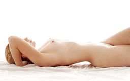 Healthy naked woman in bed Royalty Free Stock Photos