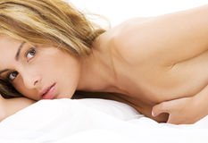 Healthy naked woman in bed Royalty Free Stock Image
