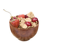 Healthy natural, cereal flakes and fruits. In wooden bowl Stock Photo
