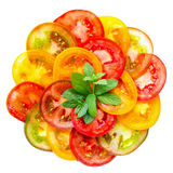 Healthy natural food colorful Tomato Slices and green  mint, Fre Stock Photo