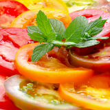 Healthy natural food colorful Tomato Slices and green  mint, Fre Stock Image