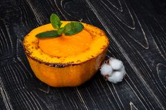 Healthy natural food, pumpkin cream soup on a black wooden background Stock Images