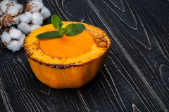 Healthy natural food, pumpkin cream soup on a black wooden background Royalty Free Stock Images