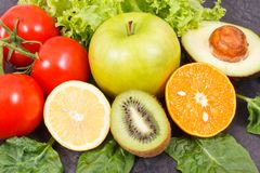 Healthy natural fruits and vegetables. Nutritious food containing minerals and vitamins royalty free stock photos