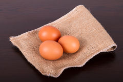 Healthy Natural Organic Eggs. Healthy organic eggs with protein on sackcloth and wooden table Stock Photography