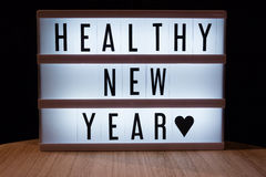 Healthy new year. `Healthy new year` text in lightbox Stock Photography
