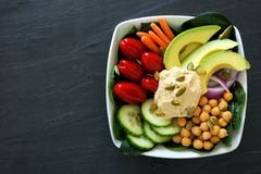 Healthy nourishment bowl with super-foods and fresh vegetables Stock Photos