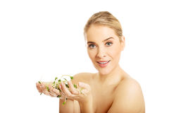 Healthy nude woman holding a cuckooflower Royalty Free Stock Images