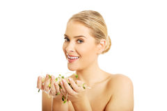 Healthy nude woman holding a cuckooflower Royalty Free Stock Photos