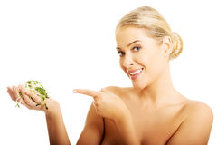 Healthy nude woman pointing on a cuckooflower Royalty Free Stock Photography