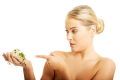 Healthy nude woman pointing on a cuckooflower Stock Images