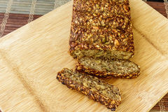 Healthy nut loaf. Vegan seed and nut loaf on wooden cutting board stock photos