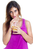Healthy nutrition. Beautiful young woman in purple shirt drinkin Royalty Free Stock Photography