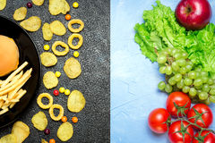 Healthy nutrition concept. Fruits and vegetables vs unhealthy fa. Healthy nutrition concept. Fruits and vegetables on light table vs unhealthy fast food and royalty free stock photos