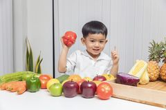 Healthy and nutrition concept. Kid learning about nutrition to choose how to eat fresh fruits and vegetables.  stock photo