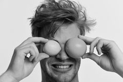Healthy nutrition concept. Man with orange and lemon instead of eyes in hands. Healthy nutrition concept. Man with orange and lemon instead of eyes in his hands stock images
