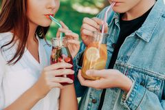 Healthy nutrition. Couple drinking detox tea. Healthy nutrition. Unrecognizable couple drinking fresh juice detox tea. Young friends lifestyle, vegetarian diet royalty free stock images