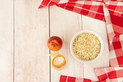 Healthy nutrition and diet with apple and oat flakes to lose wei stock photos