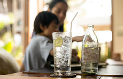 Healthy nutrition of drinking water with lemon and woman Stock Photography