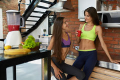 Healthy Nutrition. Fitness Women In Sportswear Drinking Smoothie Stock Photos