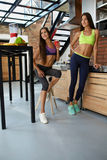 Healthy Nutrition. Fitness Women In Sportswear Drinking Smoothie Royalty Free Stock Images