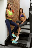 Healthy Nutrition. Fitness Women In Sportswear Drinking Smoothie Royalty Free Stock Photography