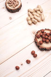 Healthy nutrition. Overhead view of different nuts, lying on wooden table with place for text Stock Images